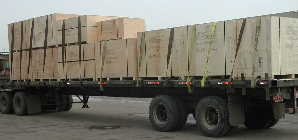 flatbed loaded with crates for shipping